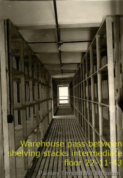 Warehouse pass between shelving stacks intermediate floor 22-11-43